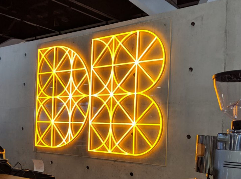 Yellow complex 3D signage display of DB logo