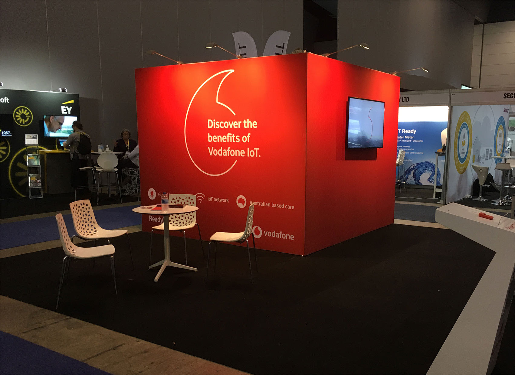Vodaphone stand for trade show using Commercial TV and red/white Illuminated fabric frame