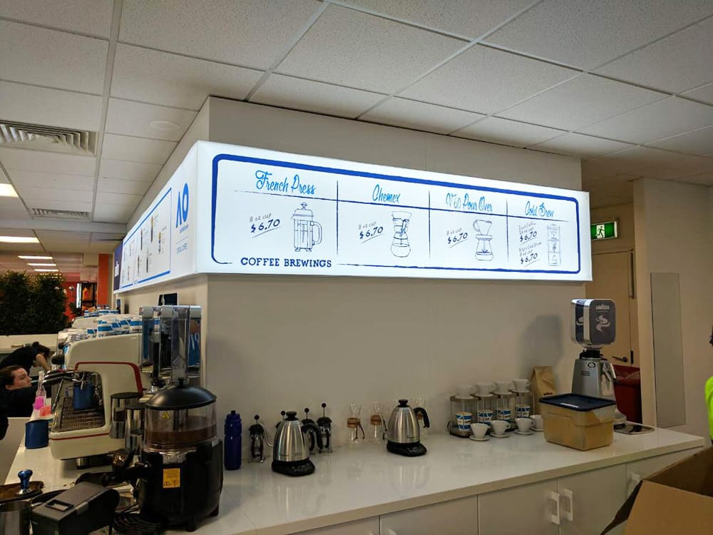 White and blue Illuminated fabric frame of Lavazza Cafe menu
