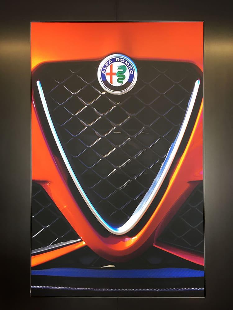 Image of Alfa Romeo car grill being illuminated by a illuminated fabric frame