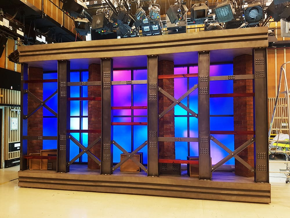 Beautiful purple, pink and blue Illuminated fabric frame for ABC Hard Quiz television studio