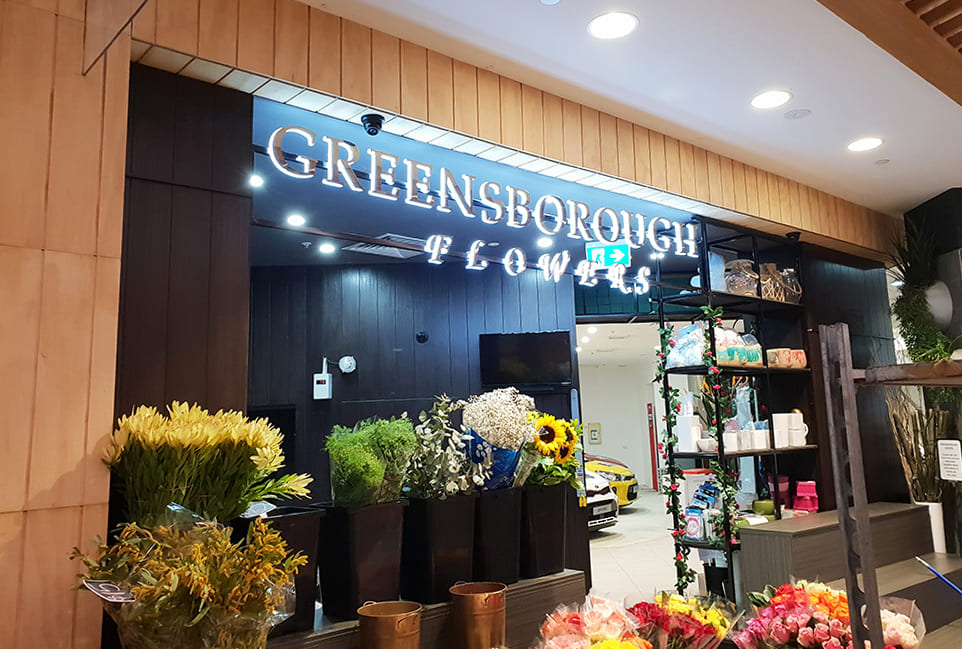 Greensborough Flower company display of flowers being illuminated by LED lighting