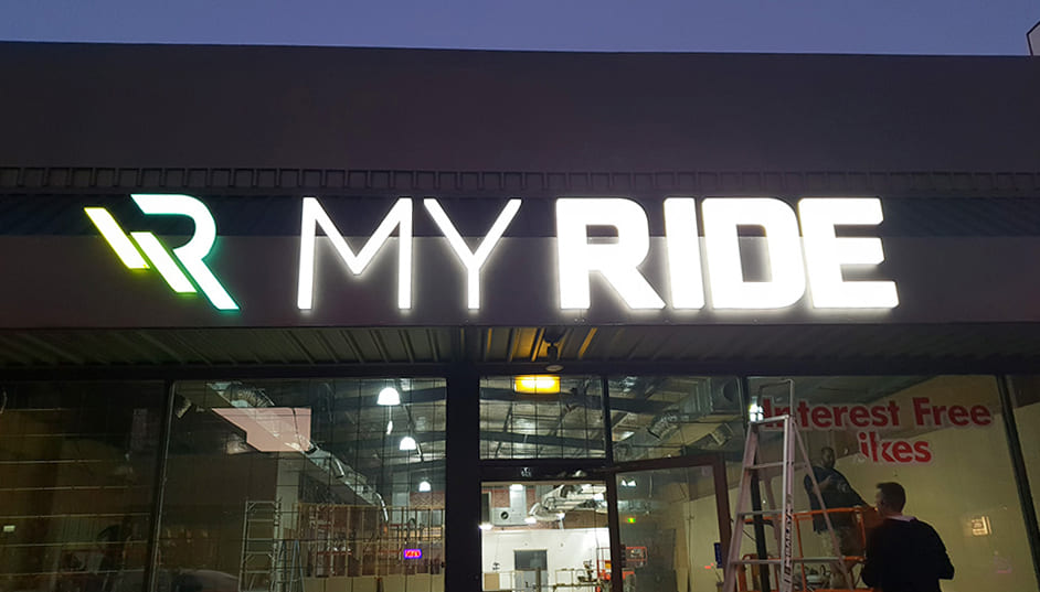 White illuminated 3D Lettering of My Ride logo at storefront