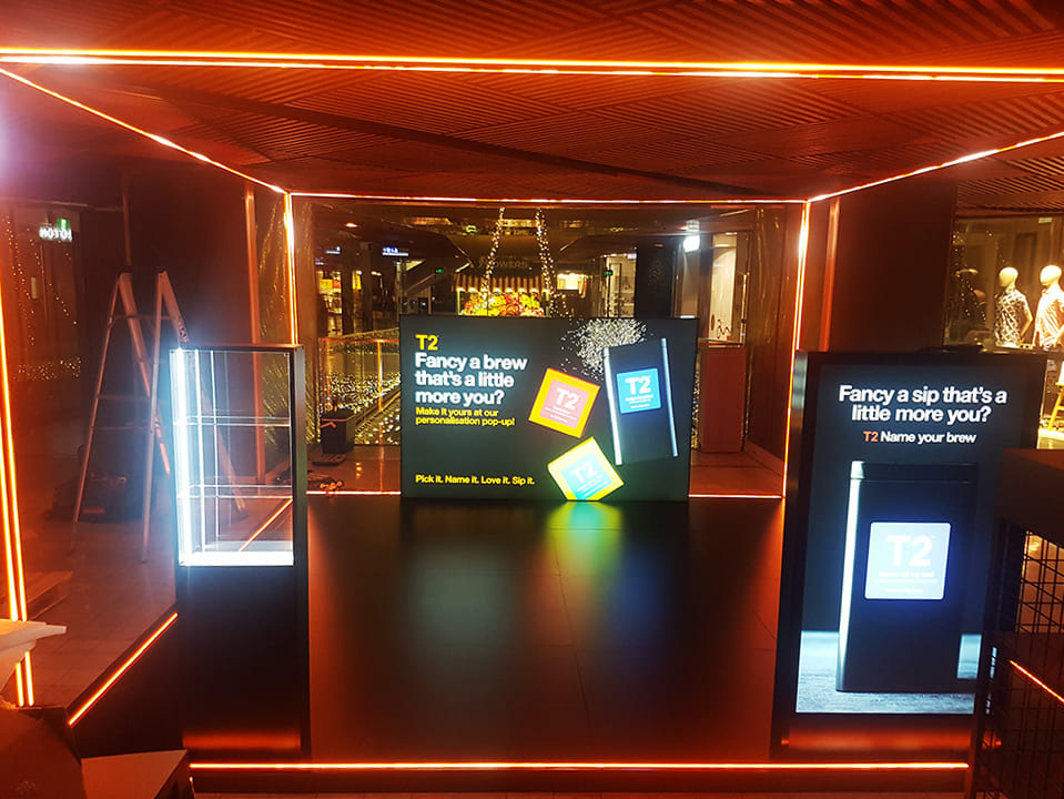 Red LED Neon strips illuminate the promotional booth of our client T2
