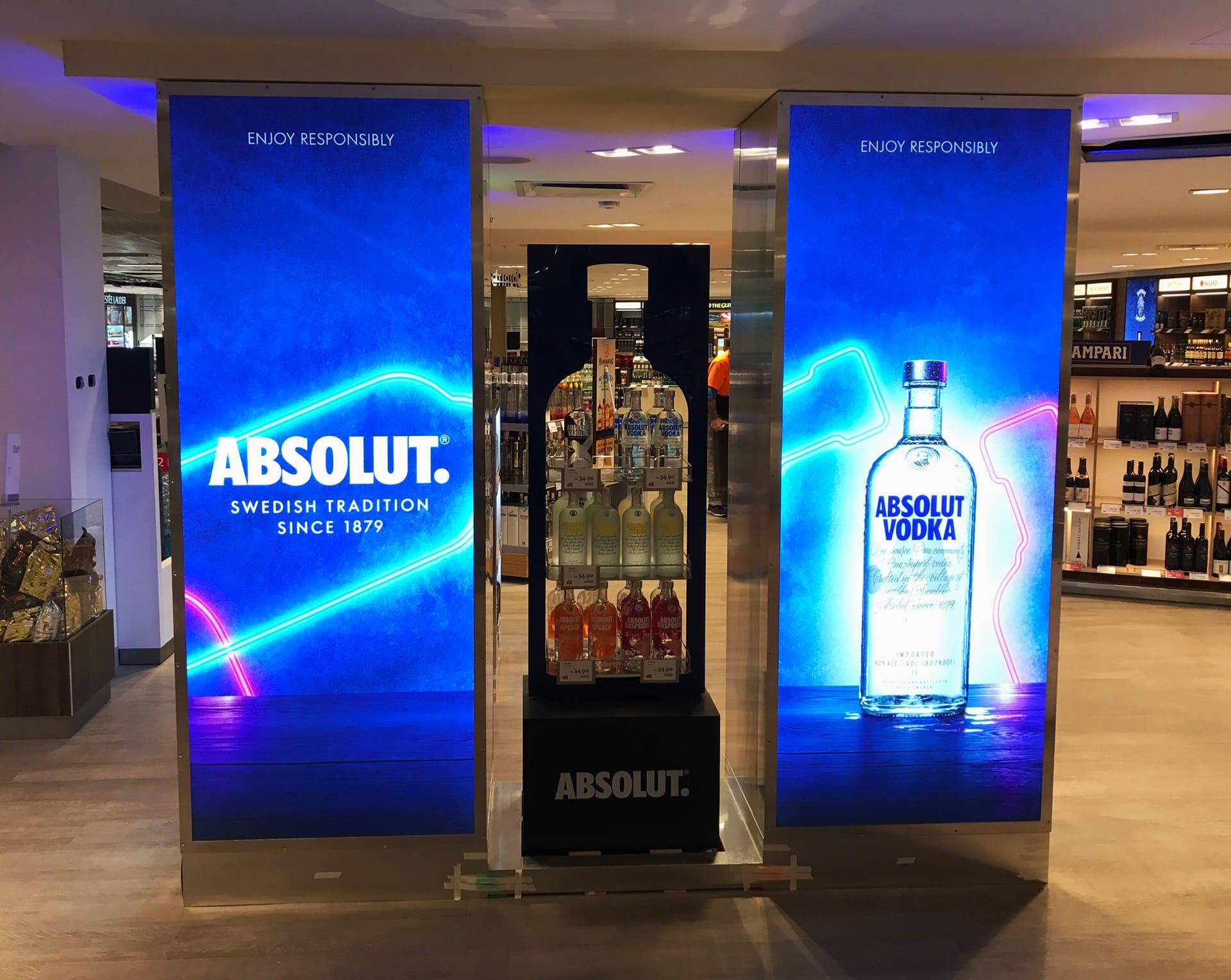 Absolut Vodka bottle and description on a LED sign