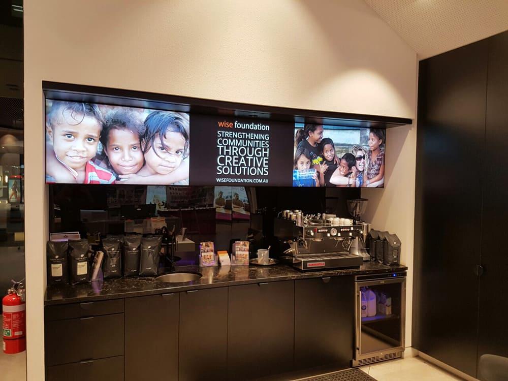 Telstra Cafe using backlit fabric frame for the menu