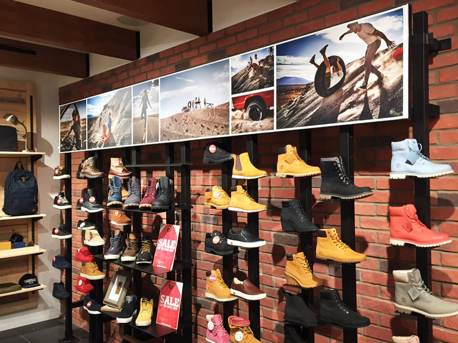 Timberlands Shoe display with Illuminated Fabric Frame of outdoor hiking images