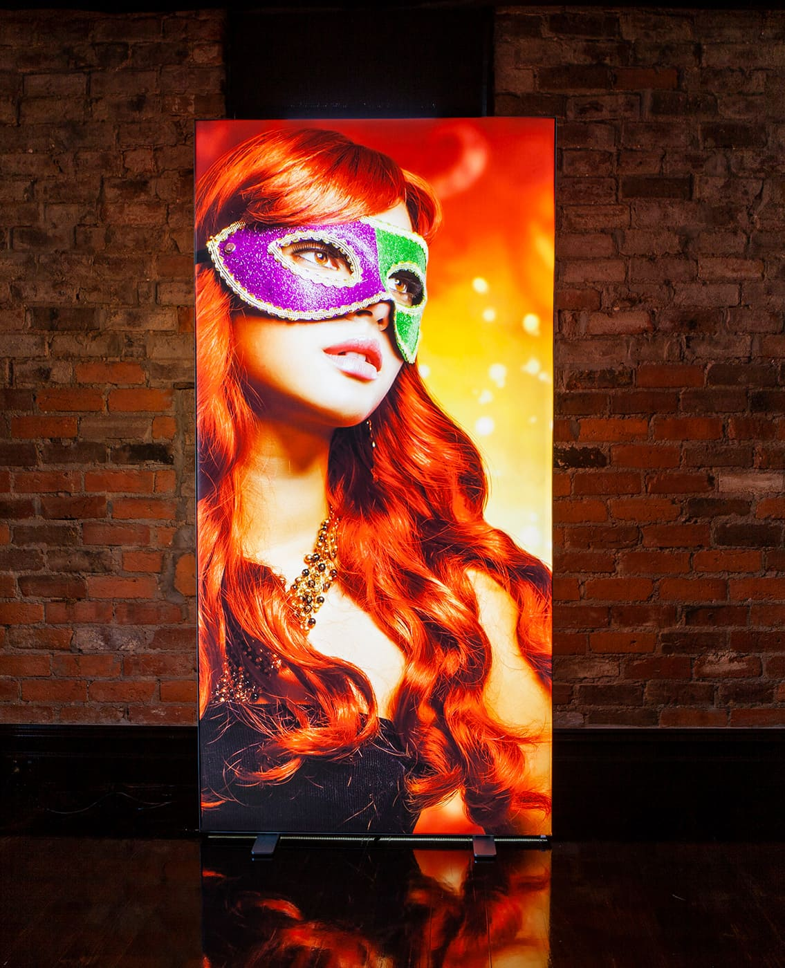 Girl with red hair and mask displayed on a Portable Lightbox