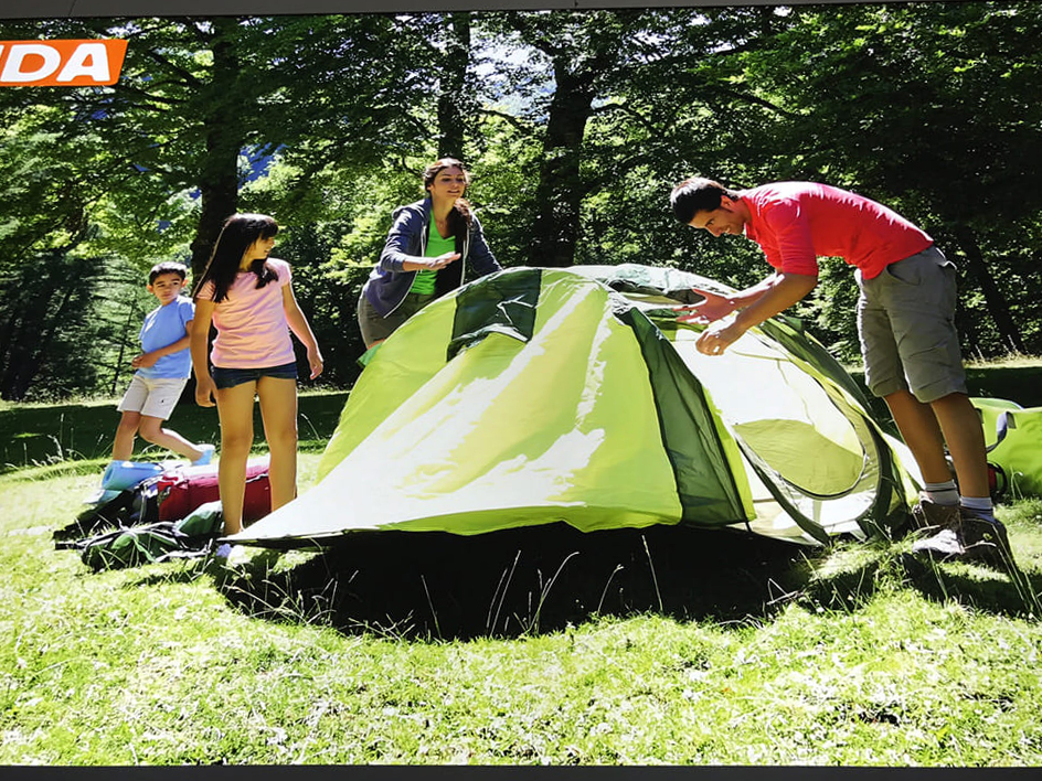 Anaconda promotional material of family setting up tent