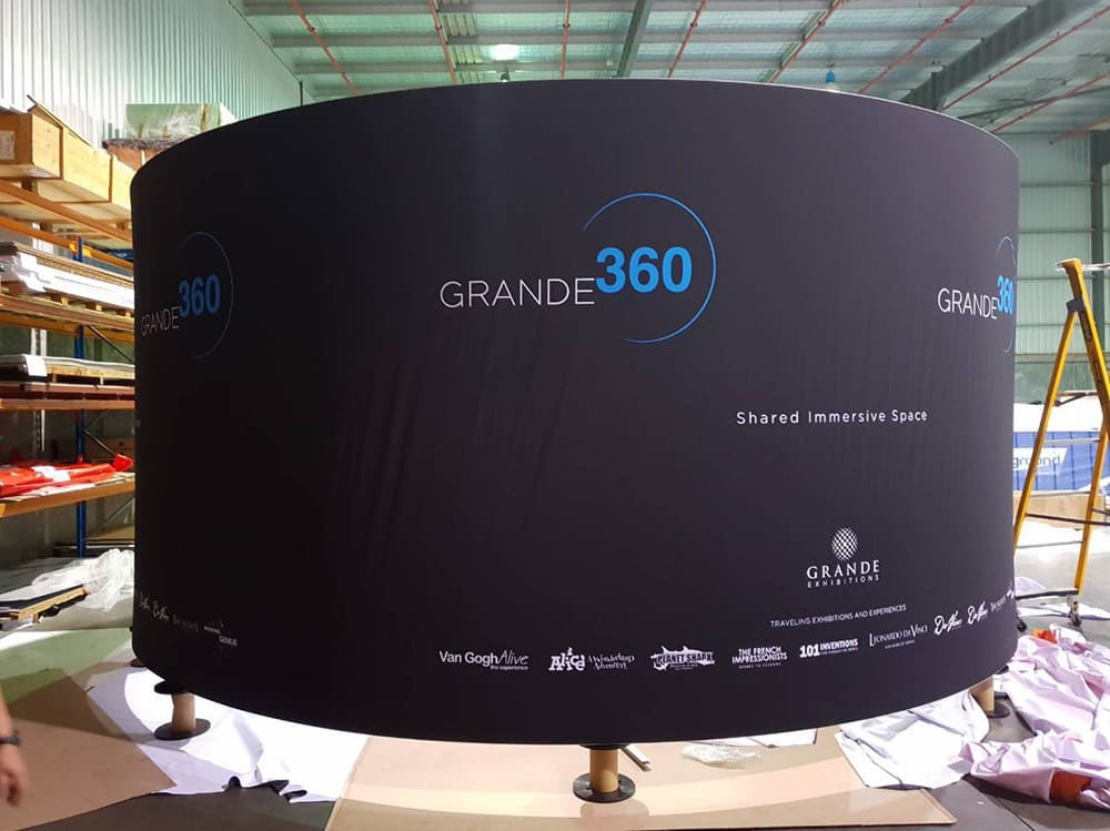 Grande Interactive Curved banner about to be hung from ceiling