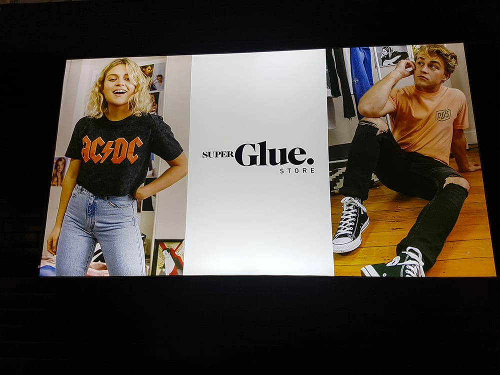 Glue Store Illuminated Fabric Frame of young trendy male and female