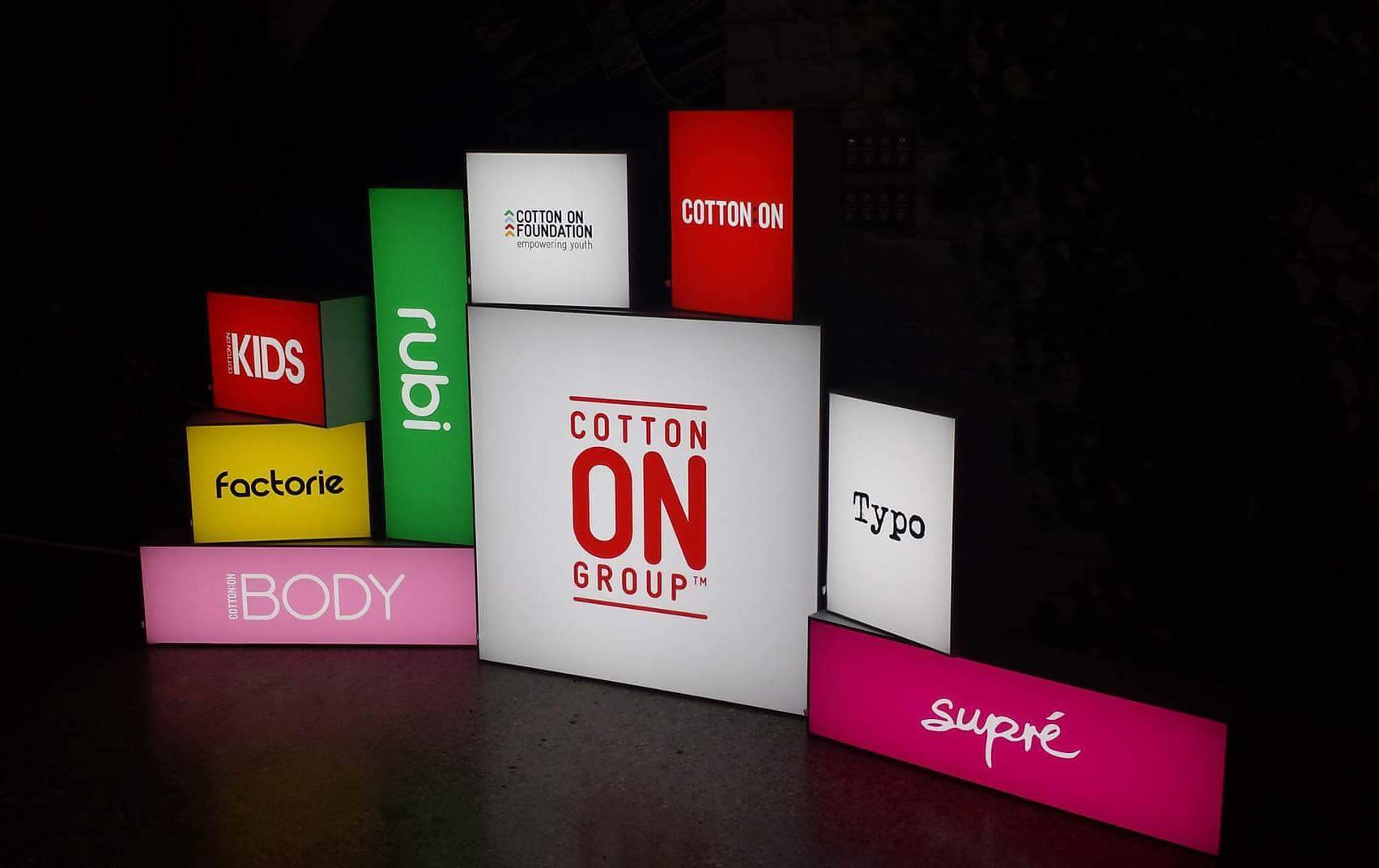 Cotton On promotional material on colourful backlit frames