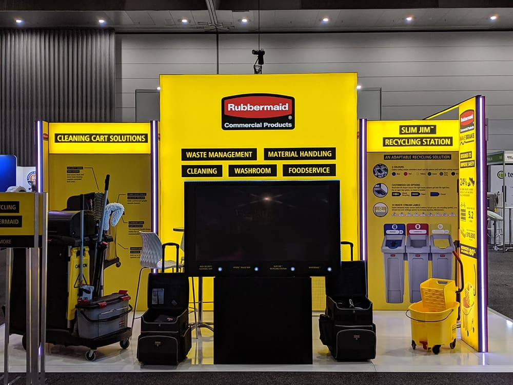 Yellow Rubbermaid stand for trade show using an illuminated FLX frame