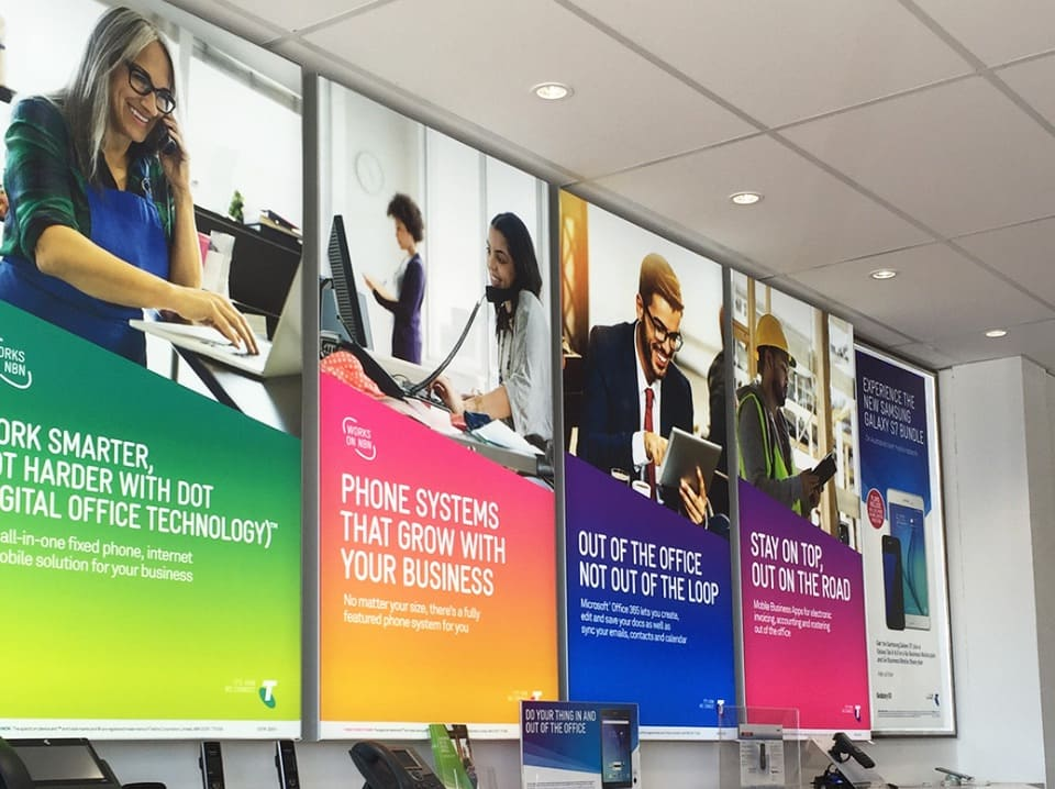 5 Acrylic Lightboxes with text and images of people working in an office