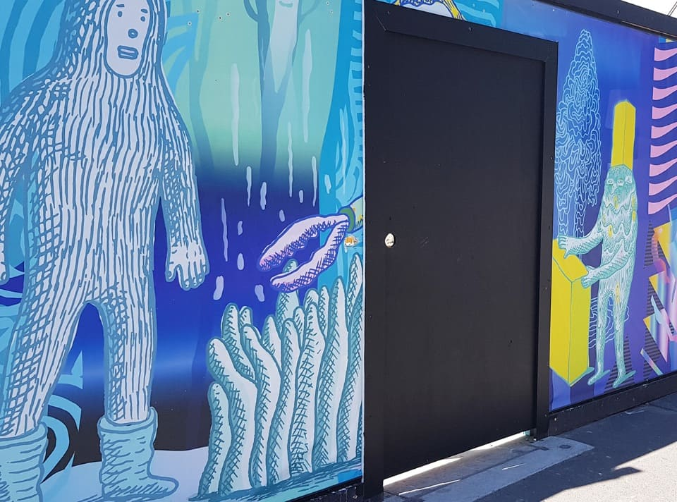A vinyl print of an underwater scene with a door in the middle